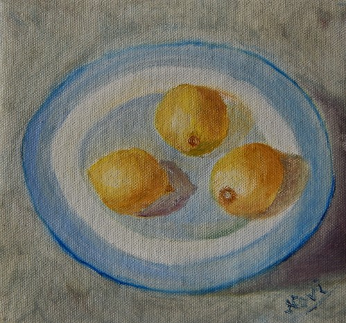 still life oil painting of lemons in a blue plate